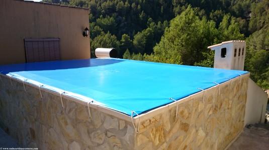 Cobertor de piscina detalles tensores con desague